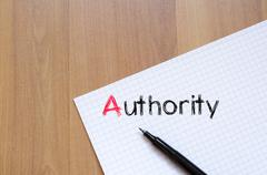 Authority text concept on notebook Stock Photos
