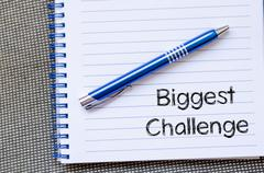 Biggest challenge text concept on notebook Stock Photos
