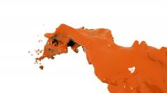 Flying orange fluid stream in slow motion DOF. Paint Stock Footage