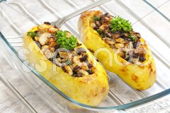 Chicken meat with black beans baked in potatoes Stock Photos