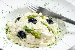 Chicken rissoto with asparagus and olives Stock Photos