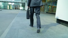 Close crop of businessman feet walking in city. Man is commuting to work Stock Footage