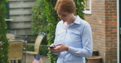 Business Woman Sending Text Messages Stock Footage
