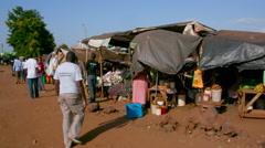 PEOPLE AT LOCAL MARKET EMALI KENYA AFRICA Stock Footage