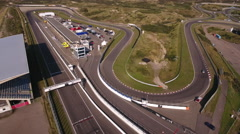 Aerial of a car racing on race circuit Zandvoort Stock Footage