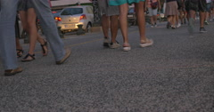 Crowd of citizens and tourists passing by, legs only Stock Footage