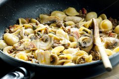 Pasta orecchiette with bacon and champignons Stock Photos
