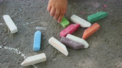 Children's hand collects crayon Stock Footage