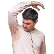 Young man with sweating under armpit in pink shirt isolated on white Stock Photos
