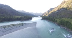Flying over the mountain river Stock Footage