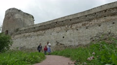 Woman with two young sons coming back from an old fortress, 4k shot Stock Footage