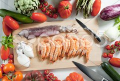 Still life of raw seafood and vegetables Stock Photos