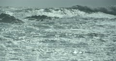 Rough seas with waves in slow motion illuminated by sunlight Stock Footage