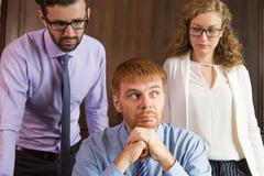 Young business people thinking on some issue Stock Photos