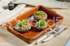 Baked champignons filled with peanuts mixture Stock Photos