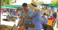 Young family in market of Thessaloniki, Greece choose peaches Stock Footage