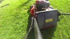 Starting Lawnmower - Mowing Grass - Push Mower Stock Footage