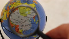 East Asia - Desktop Political Globe Element through a magnifying glass Stock Footage
