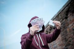 Pusher selling and trafficking drug dose for money cash Stock Photos