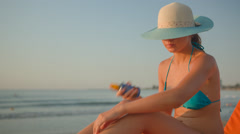 Girl sun tanning oil Stock Footage