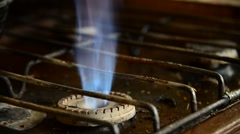 Flames from a gas burner on old kitchen stove Stock Footage