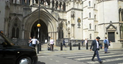 The Strand and The Royal Courts of Justice, London, UK Stock Footage