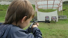 Close-up of a boy teen shooting a crossbow at a target outdoors, Full HD shot Stock Footage