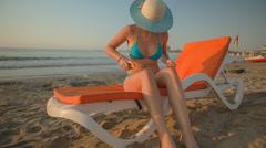 Girl sun tanning oil Stock Footage