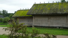 Old wooden farm house with moss on the roof, Full HD shot Stock Footage