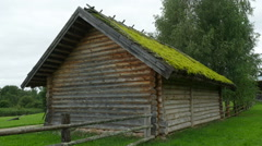 Old wooden house with moss on the roof, Full HD footage Stock Footage