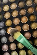 Skin color shade of eye shadow with green brush Stock Photos
