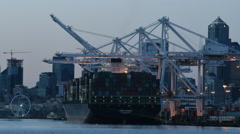 Seattle container port at dusk, as lights come on Stock Footage