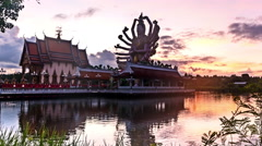 Dawn over the lake and the Buddhist temple Stock Footage