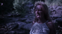 Witch in forest at night. Vampire Rocks. ghost. Fantasy and gothic. halloween Stock Footage