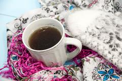 Cosy soft winter background, knitted sweater Cup hot coffee old vintage woode Stock Photos