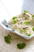 Mushroom dumplings in egg-plan cream Stock Photos