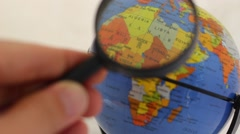 Africa and the Middle East. Political Globe through a loupe Stock Footage