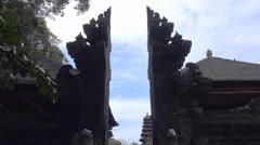 4k Holy bat temple entry portal tilt down Goa Lawah sculptures Bali Stock Footage