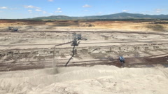 Aerial view of a lignite open pit mine - bucket wheel excavator Stock Footage