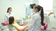 Women dentists working at patients teeth Stock Footage