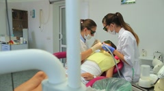 Beautiful young women dentists at work in the office Stock Footage
