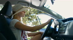 Girl drinks water. Woman sitting behind the wheel. 4K 30fps ProRes (HQ) Stock Footage