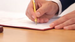 Male Hand Puts The Signatures On The Document Stock Footage