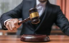 Auctioneer is hitting with gavel. Auction and Justice concept. Stock Photos