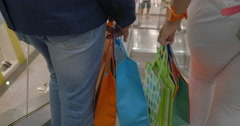 Close up back view of woman and man hands with paper bag Stock Footage