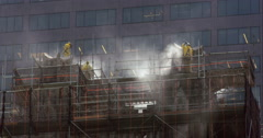 Workers power wash the top of a New York City church. Stock Footage