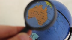 Commonwealth of Australia - World Globe Element through a magnifying glass Stock Footage
