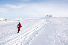 Woman hiking in snow, Peak District, Derbyshire, UK Stock Photos
