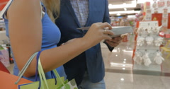 In store of Thessaloniki, Greece a man and a woman choose a product Stock Footage