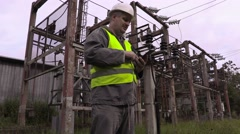 Electrician take pictures in electrical substation Stock Footage